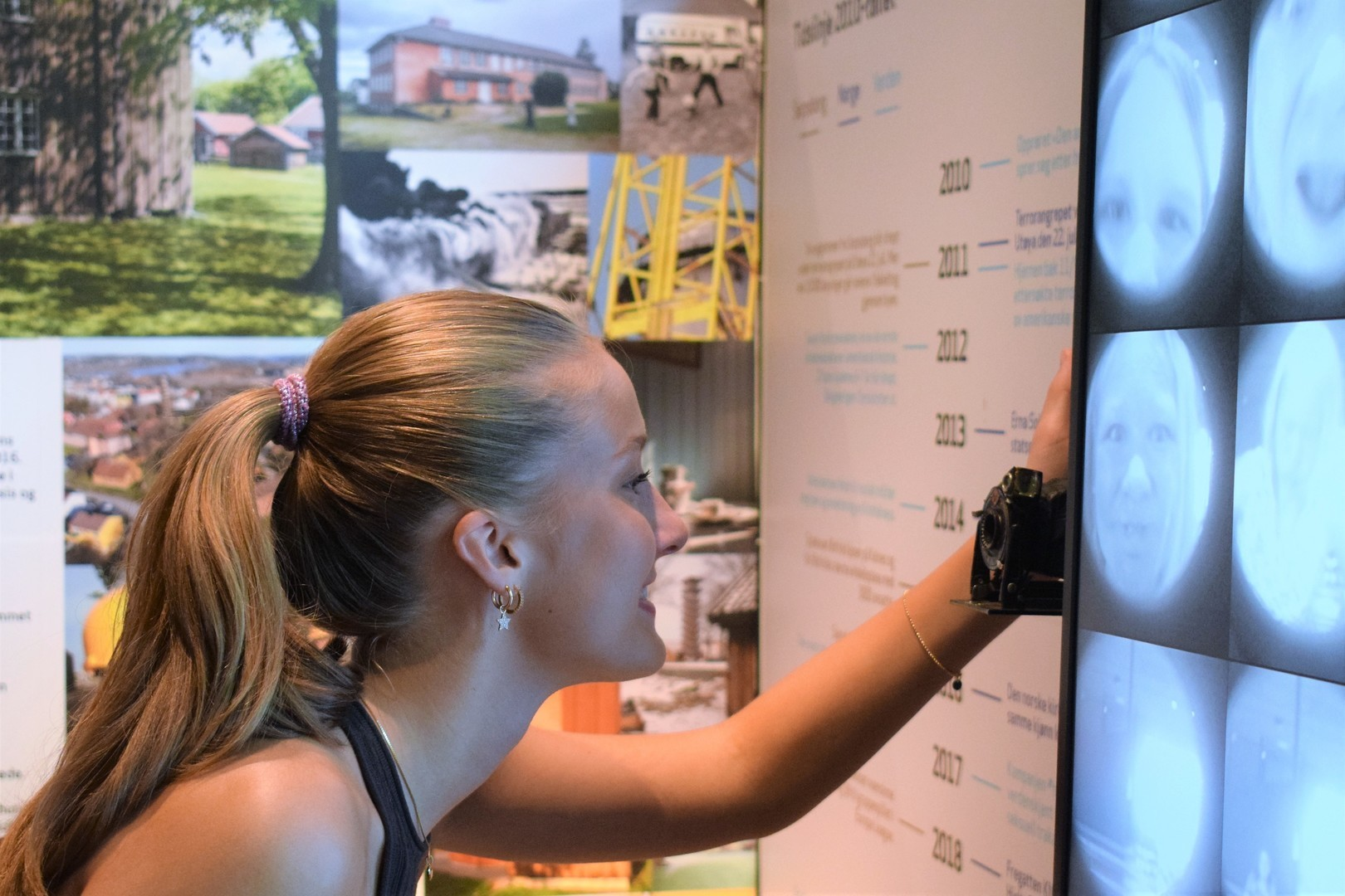 Visitors interact with photo booth installation